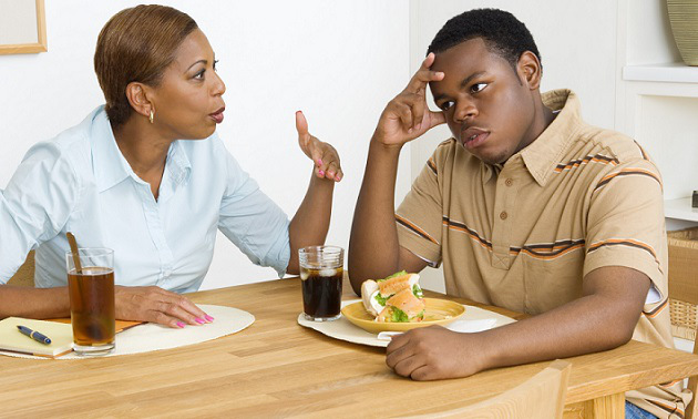 Mother scolding son during lunch